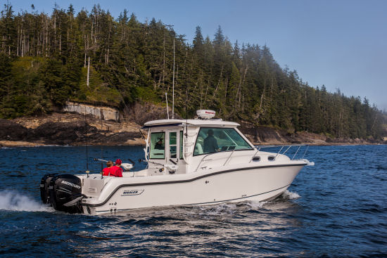 Boston Whaler 315 Conquest Pilothouse running shot